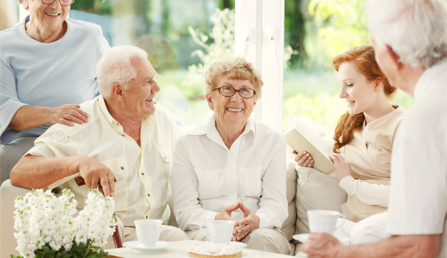 a group of senior with their caregiver